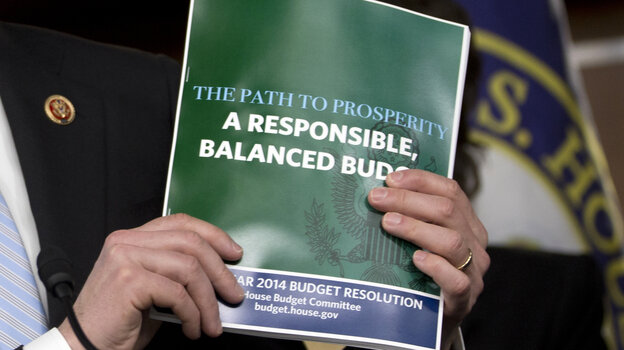 House Budget Committee Chairman Rep. Paul Ryan, R-Wis., holds a copy of his budget plan during a news conference last wee