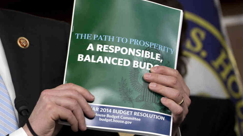 House Budget Committee Chairman Rep. Paul Ryan, R-Wis., holds a copy of his budget plan during a news conference last
