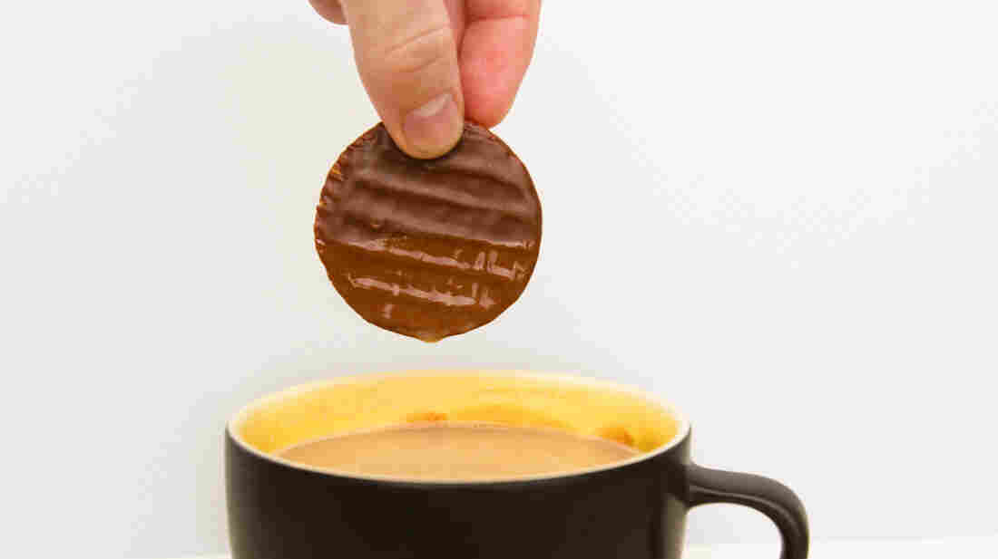 Just a little plunge into hot tea makes a chocolate-covered biscuit release its flavor more quickly in your mouth.