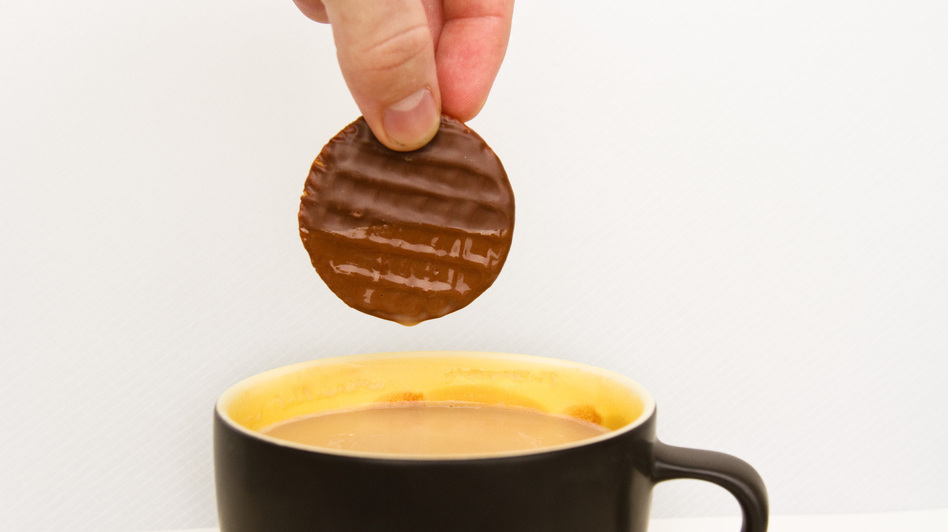 Just a little plunge into hot tea makes a chocolate-covered biscuit release its flavor more quickly in your mouth. (NPR)