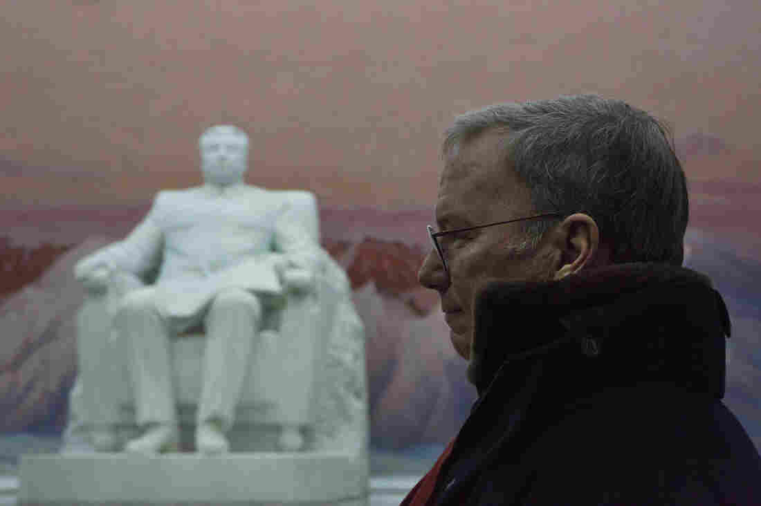 Eric Schmidt, Google's executive chairman and former CEO, stands near a statue of the late North Korean leader Kim Il Sung in Pyongyang in January. He's headed now to Myanmar, another largely untapped market.