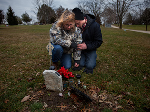 Will Piper and Annette Pacas visit the grave of Annette's son, Alex, at Oak Hill Cemetery in Mount Carroll, Ill. Piper says he hopes to raise money to replace the makeshift, plastic marker with a permanent gravestone.
