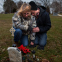 Will Piper and Annette Pacas visit the grave of Annette's son, Alex, at Oak Hill Cemetery in Mount Carroll,