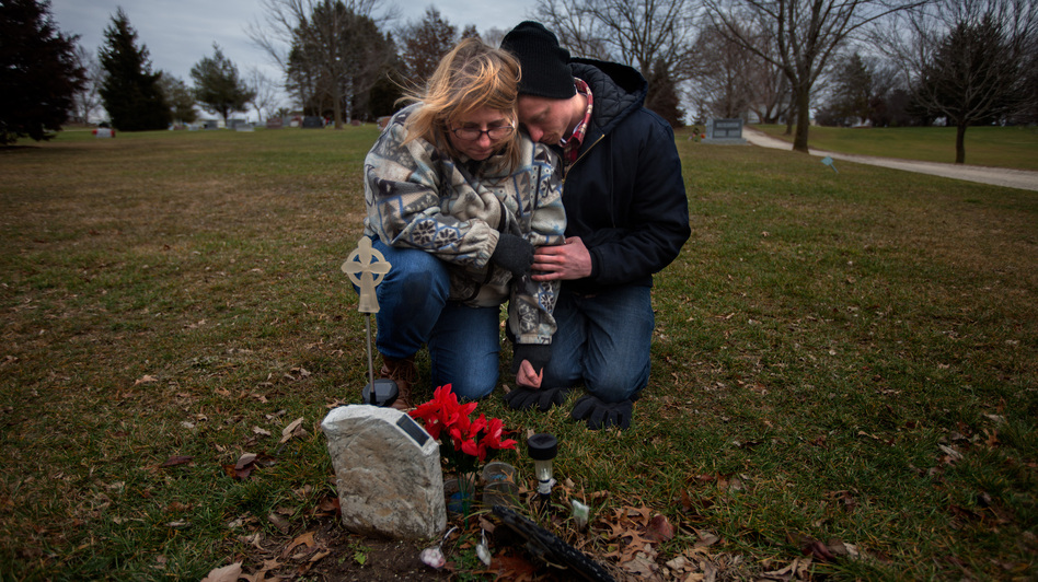 Will Piper and Annette Pacas visit the grave of Annette's son, Alex, at Oak Hill Cemetery in Mount Carroll, Ill. Piper says he hopes to raise money to replace the makeshift, plastic marker with a permanent gravestone. (NPR)