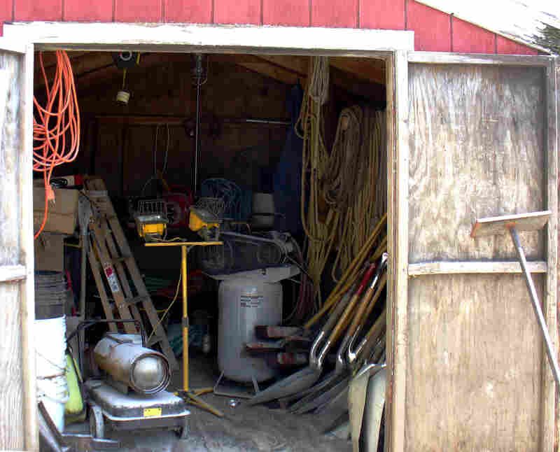 This photo from OSHA's investigation file shows harnesses and ropes hanging unused in a shed close to Bin No. 9. OSHA cited Haasbach LLC for failing to provide its workers with required safety devices, and for failing to train them in safety procedures.