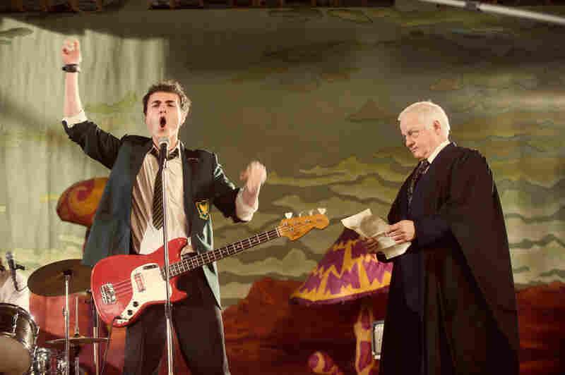 Lewis' (Adam Byard) spirited performance in the rock-musical production fails to amuse his stern headmaster (Robert Pugh).