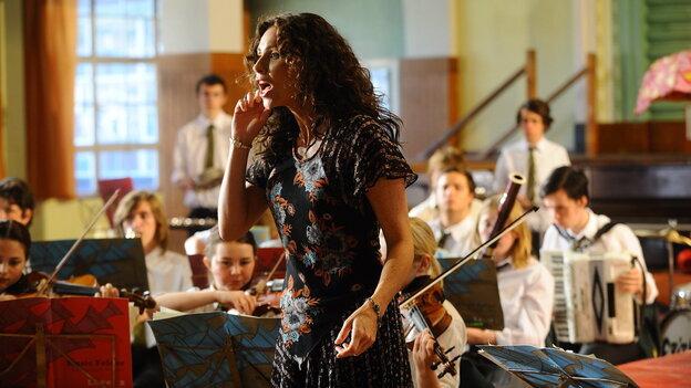 Free-spirited drama teacher Viv (Minnie Driver) hopes to use a summer musical production