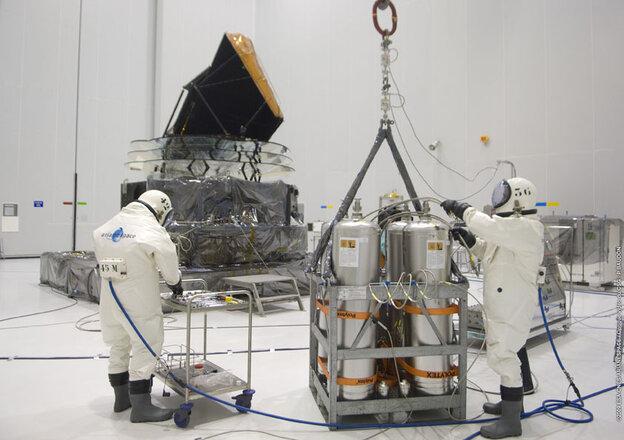 Technicians prepare the Planck satellite for hydrazine fueling in April 2009.