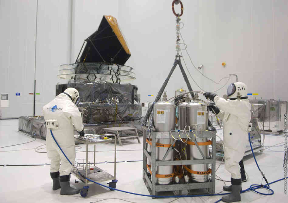 Technicians prepare the Planck satellite for hydrazine fueling in April 2009.