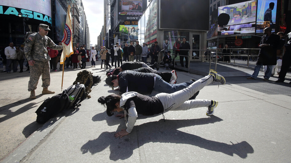 Army recruits perform exercises as part of a demonstration for tourists in front of the military-recruiting station in New York's Times Square. (AP)