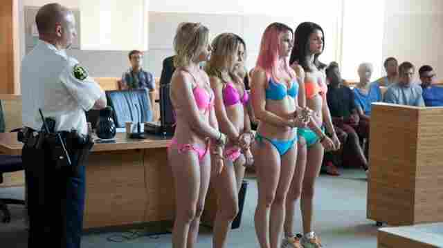 The girls of Spring Breakers (from left, Ashley Benson, Vanessa Hudgens, Rachel Korine and Selena Gomez) live in the kind of fluorescent world where skimpy bathing suits fit within court appearance dress codes.