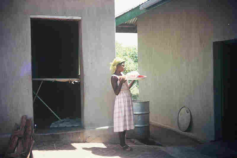 """""""This young woman most probably worked as a maid to the missionaries, perhaps even my mother. Young people were chosen as house help for a variety of reasons: they came from a broken home, their parents could not feed them, or perhaps they were especially gifted and their parents requested the white man's schooling."""""""