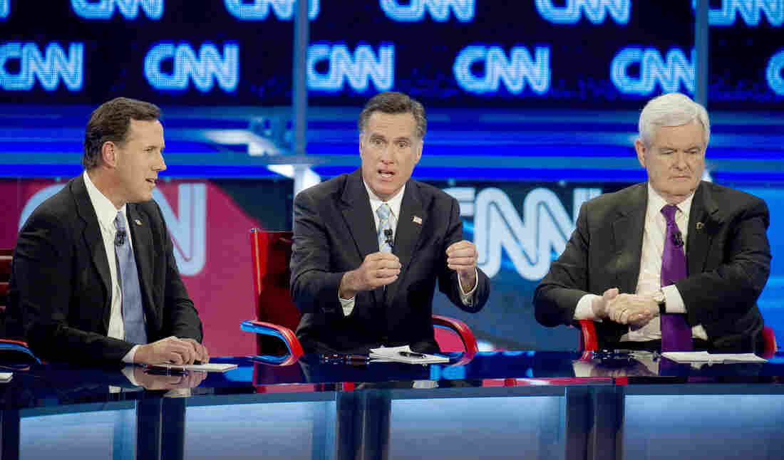 Presidential candidates Rick Santorum, left, Mitt Romney, center, and Newt Gingrich during a debate in February of 2012.