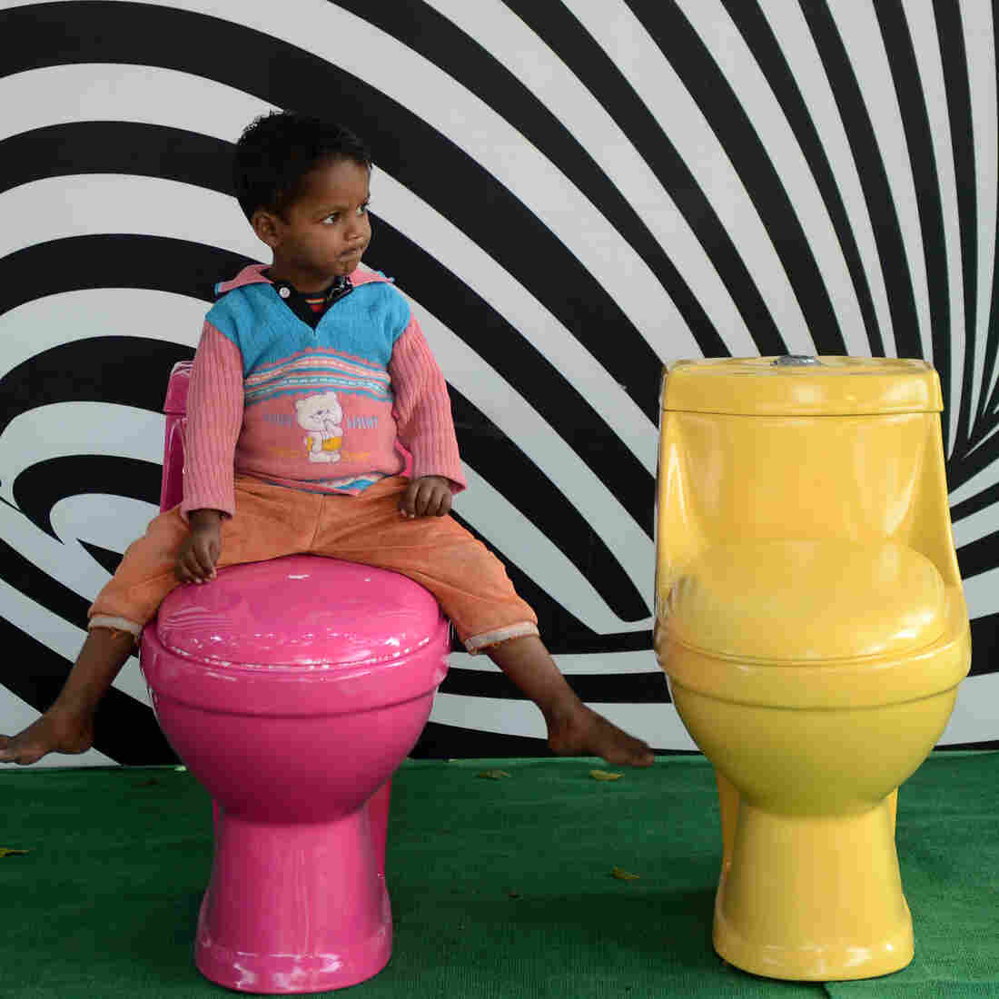 Talk Globally, Go Locally: Cellphones Vs. Clean Toilets