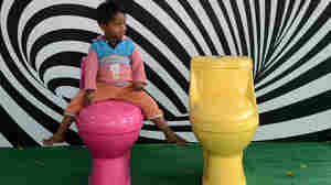A young boy plays on a commode during an event for World Toilet Day in New Delhi in November. An estimated 131 million Indian homes don't have a latrine or a clean toilet.