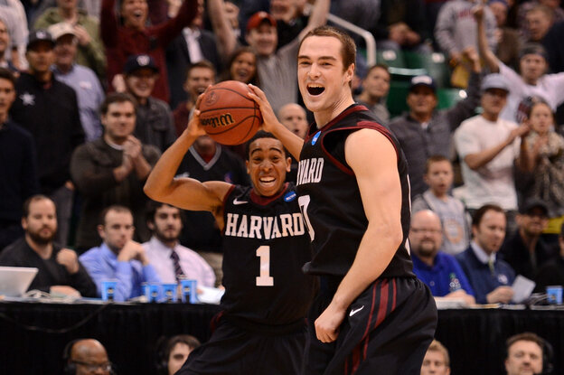 Siyani Chambers and Laurent Rivard of the Harvard Crimson celebrate as the Crimson defeat the New Mexico Lobos 68-62 during the t