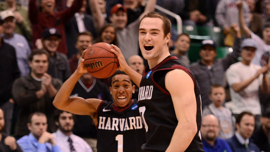 Siyani Chambers and Laurent Rivard of the Harvard Crimson celebrate as the Crimson defeat the New Mexico Lobos 68-62 during the the 2013 NCAA Men's Basketball Tournament on Thursday in Salt Lake City, Utah. (Getty Images)