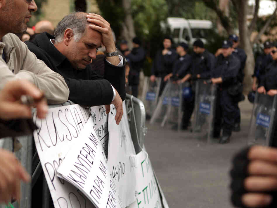 An employee of Cyprus Laiki (Popular) Bank reacts as he takes part in a protest outside Parliament on Friday in the capital, Nicosia.