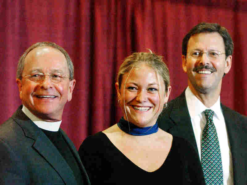 The Rev. Gene Robinson, along with his daughter Ella and partner Mark Andrew, attend a news conference after Robinson was confirmed as bishop of the Episcopal Church in Minneapolis in 2003. Robinson was the church's first openly gay bishop, and his daughter is an advocate for gay marriage.