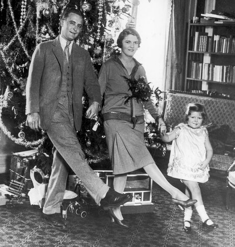 "F. Scott Fitzgerald dances with his wife, Zelda, and daughter, Frances ""Scottie,"" in front of a Christmas tree in Paris."