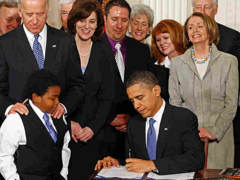 President Obama signs the Affordable Care Act at the White House o