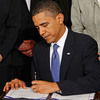 President Obama signs the Affordable Care Act at the White House on March 23, 2010.