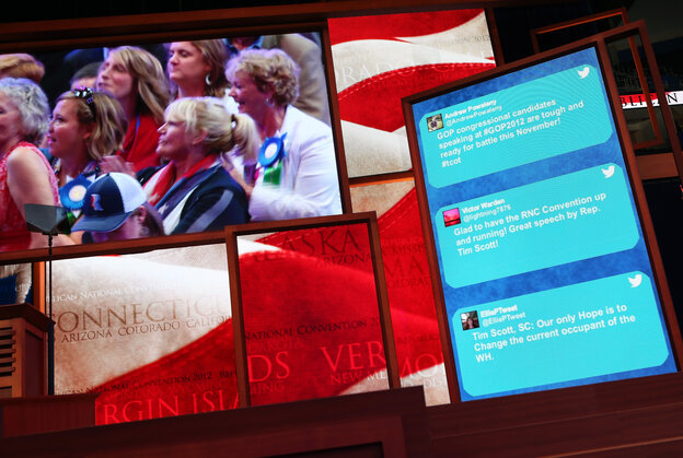 Tweets from GOP supporters scroll along the side of a large-scr