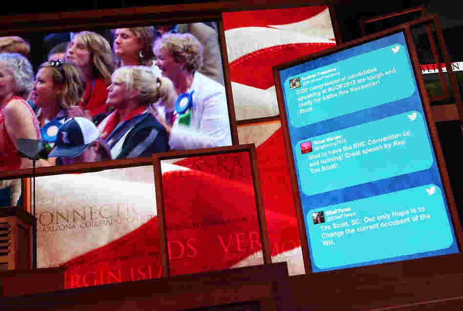 Tweets from GOP supporters scroll along the side of a large-screen display at the Republican National Convention in Tampa, Fla., on Aug. 28, 2012.