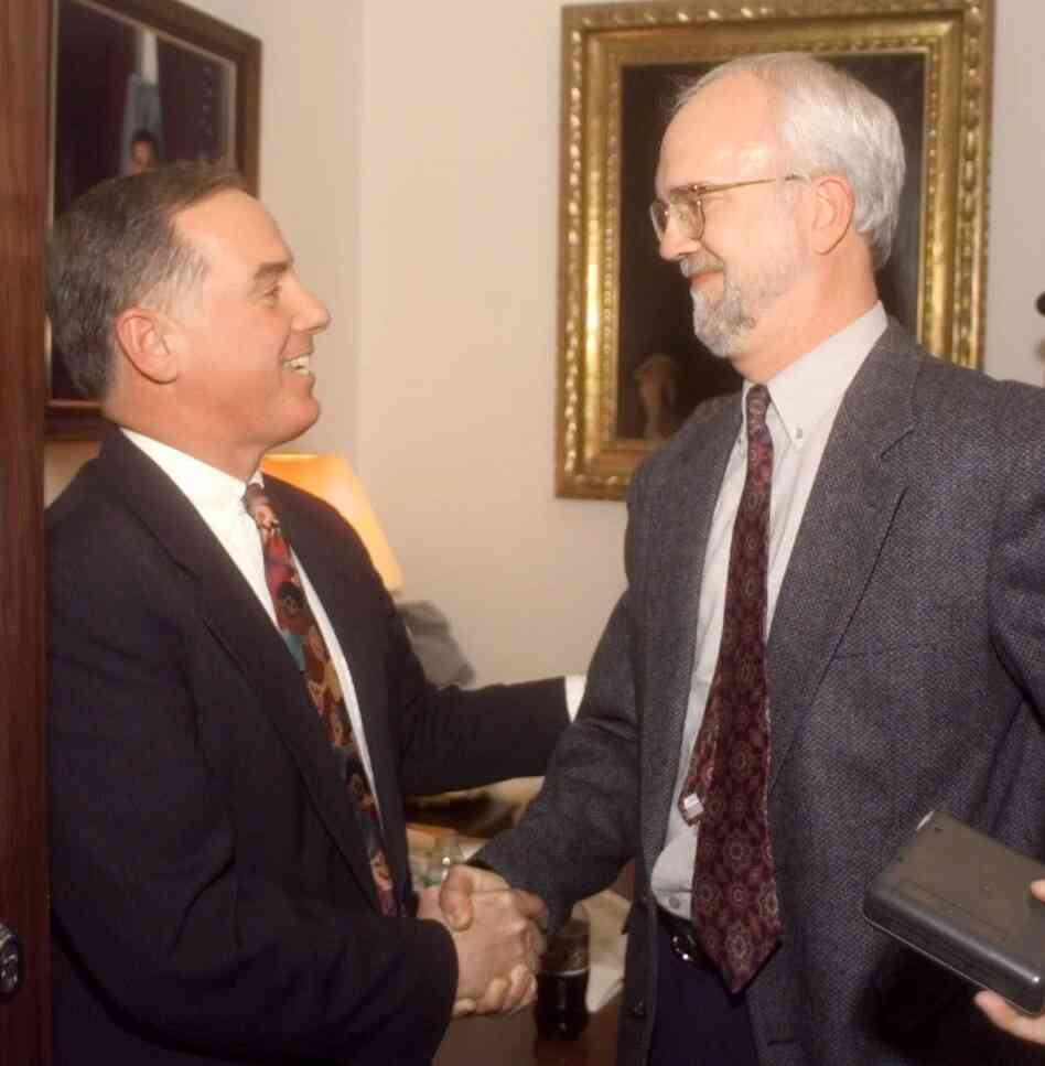 Vermont Gov. Howard Dean, (left) shakes hands with state Rep. William Lippert at the Statehouse after Dean signed the civil union law on April 26, 2000.