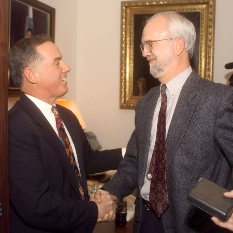 Vermont Gov. Howard Dean, (left) shakes hands with state Rep. William Lippert at the Statehouse after Dean signed the civil union law on April 26, 2000. (AP)