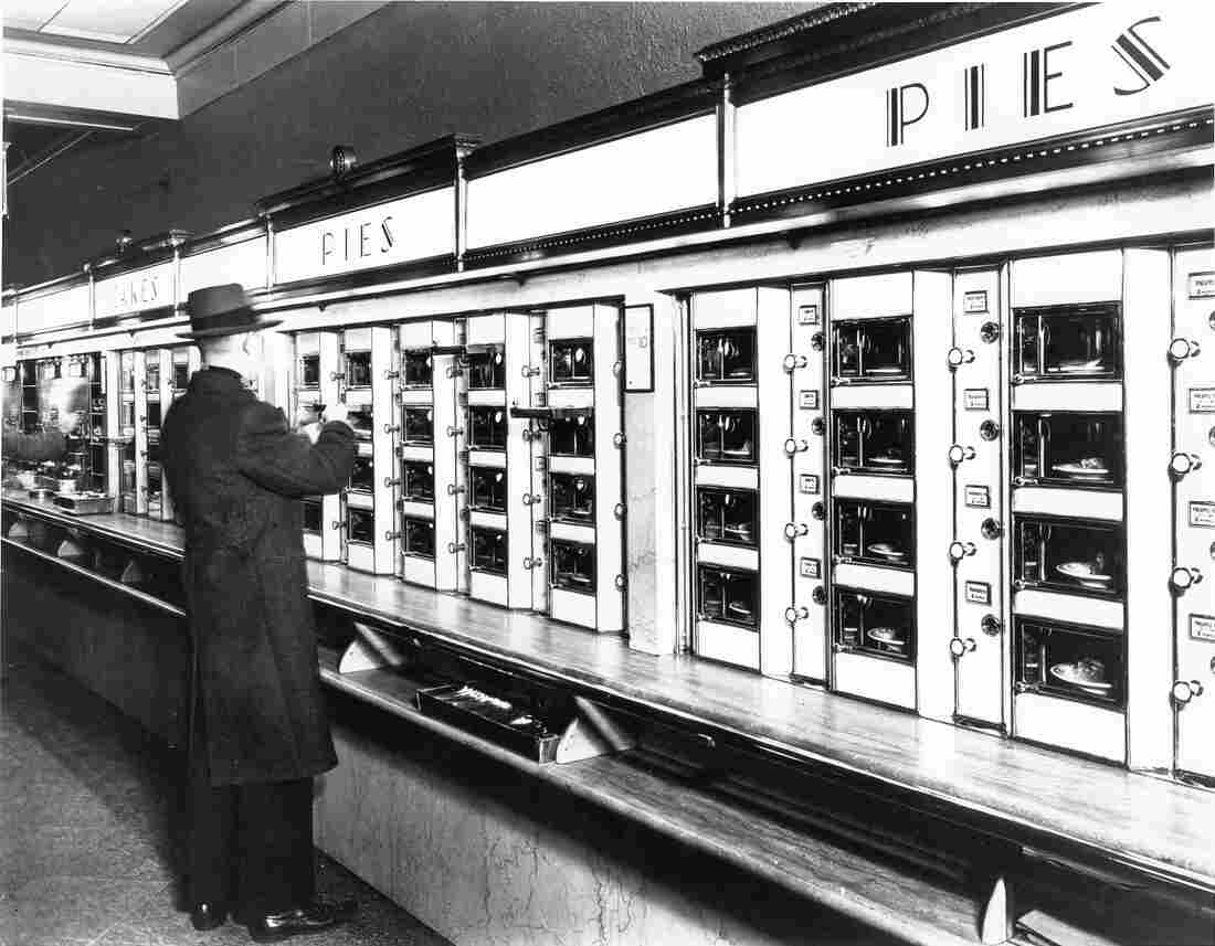 A customer selects his food at a Horn & Hardart's Automat in New York City.