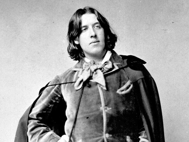 Playwright Oscar Wilde poses in an 1882 photo.