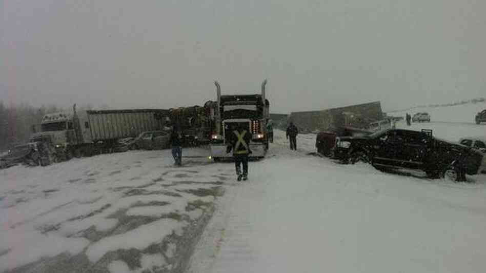 A blizzard traps cars, trucks and even a cattle car on a Canadian highway, causi