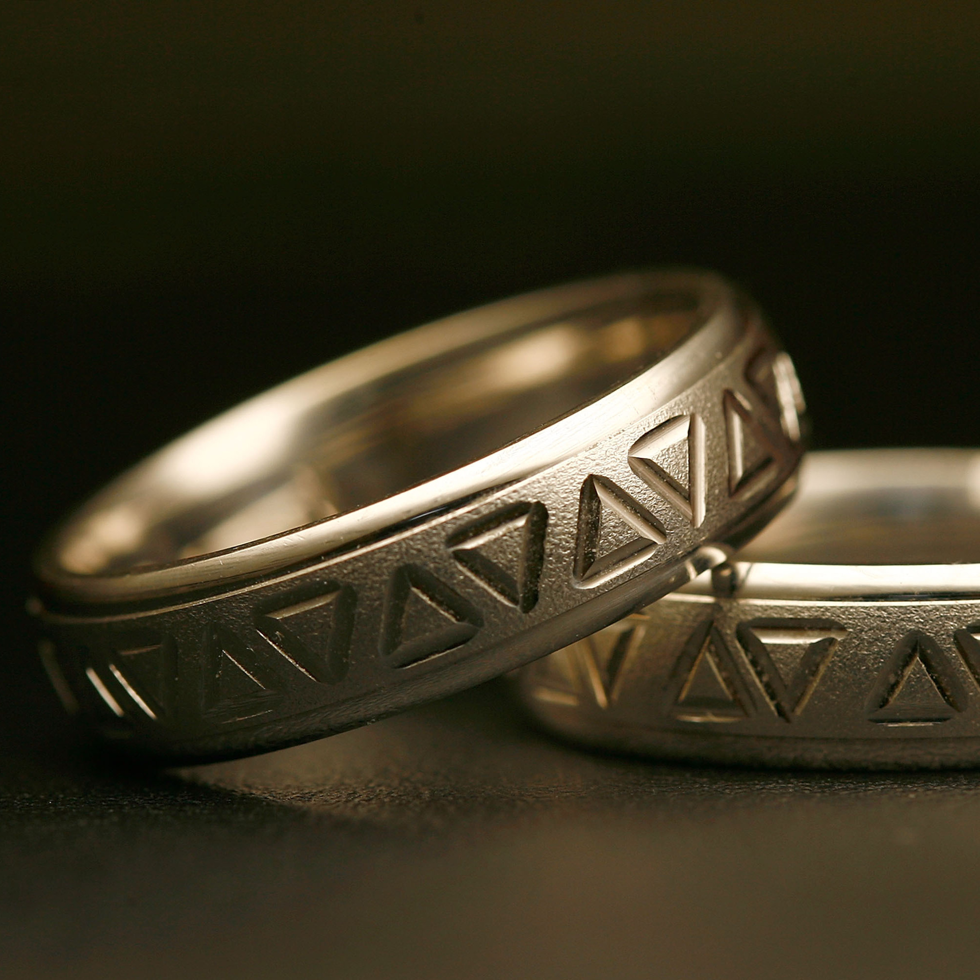 Same-sex wedding rings are engraved with triangles, a symbol of gay pride. Detractors say extending recognition to same-sex couples will weaken a bedrock institution meant to protect women and children.
