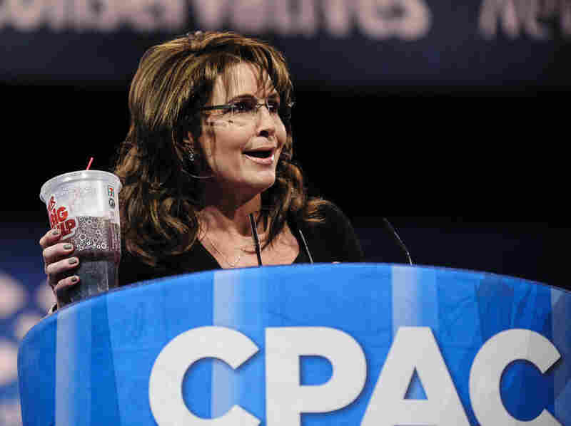 Sarah Palin, former governor of Alaska, holds up a large soda as she speaks about New York City Mayor Michael Bloomberg's proposed large soda ban at the 2013 Conservative Political Action Conference.