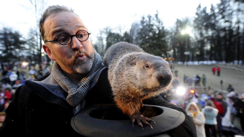Groundhog handler Ben Hughes and Punxsutawney Phil in Feb. 2011.