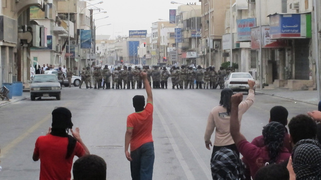 Anti-riot police face off with protesters in Saudi Arabia's eastern city of Qatif on March 11, 2011. Despite bans on the demonstrations, Shiite Muslims in the eastern part of the country have continued to stage protests, demanding political changes. (Reuters /Landov)