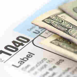 A 1040 tax form and cash.