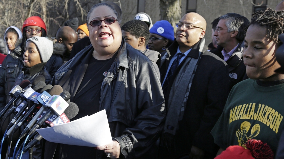 Chicago Teachers Union President Karen Lewis speaks outside Mahalia Jackson Elementary School in Chicago about the planned closing of 54 public schools. Opponents say the plan will disproportionately affect minority students in the nation's third-largest school district. (AP)