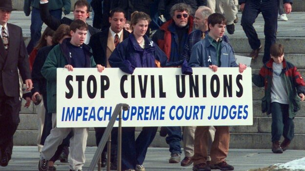 Demonstrators protest outside the Statehouse in Montpelier, Vt., in April 2000, the month the nation's first law recognizing same-sex civil unions was signed by the governor. (AP)