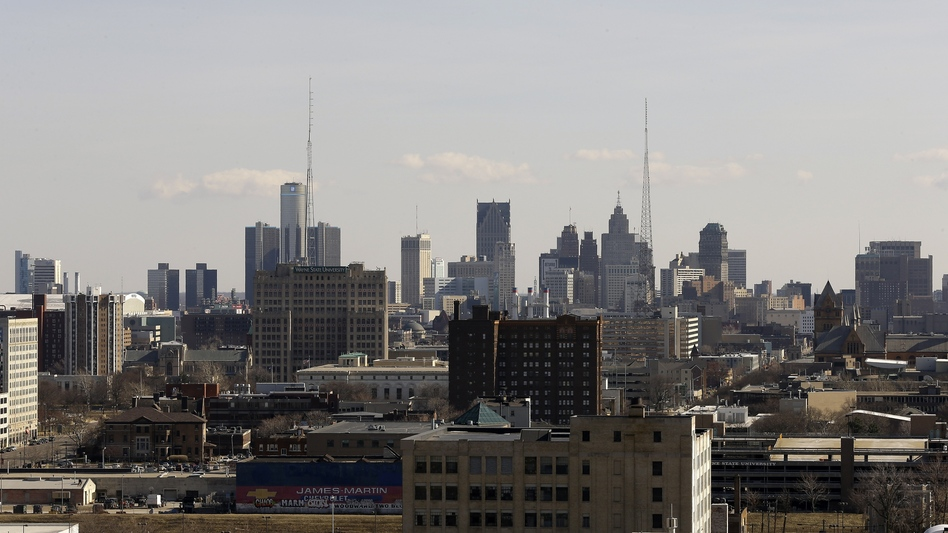 The population of Detroit has dwindled, and now there aren't enough taxpayers to pick up the tab for essential city services. (Paul Sancya/AP)