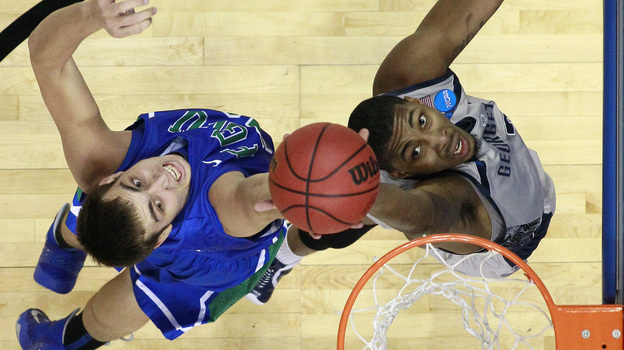 Florida Gulf Coast's Chase Fieler (left) and Georgetown's Mikael Hopkins leap for a rebound during a second-round game of the NCAA tournament Friday. (AP)