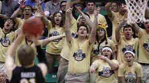 Pittsburgh fans try to distract Wichita State's Ron Baker as he shoots a free throw during a second-round game in the NCAA college basketball tournament in Salt Lake City on Thursday. The distractions of the tournament are so great that worker productivity suffers.
