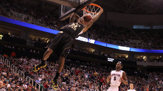 Carl Hall No. 22 of the Wichita State Shockers dunks the ball in the first half while taking on the Gonzaga Bulldogs during the third round of the NCAA men's basketball tour