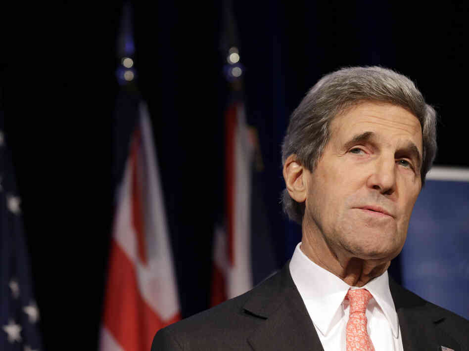 Secretary of State John Kerry is in Baghdad Sunday on an unannounced visit following President Obama's M