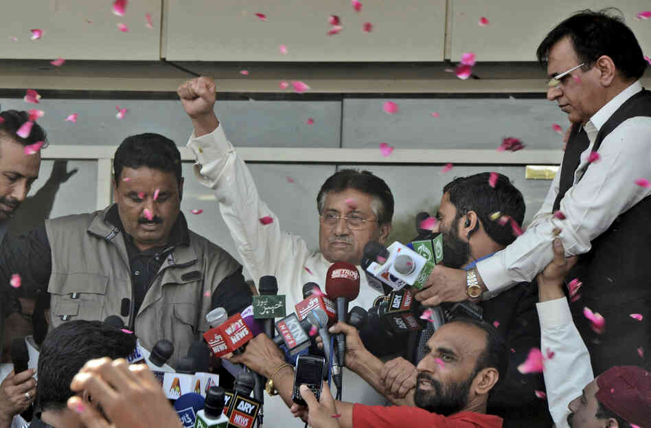 Former Pakistani President Pervez Musharraf greets supporters upon his arrival at Karachi airport in Pakistan on Sunday.