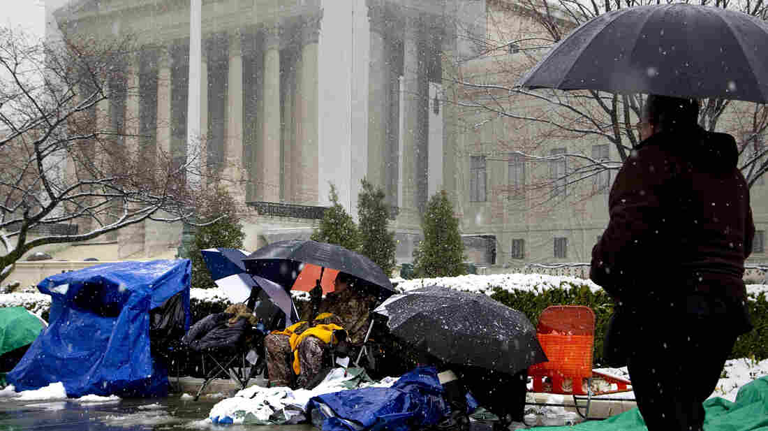 People wait through winter weather Monday outside the U.S. Supreme Court, in line hoping to attend oral arguments in the same-sex marriage cases being argued Tuesday and Wednesday.