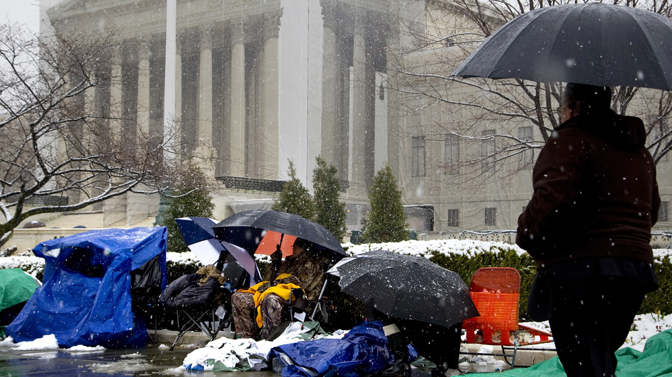 People wait through winter weather Monday outside the U.S. Supreme Court, in line hoping to attend oral arguments in the same-sex marriage cases being argued Tuesday and Wednesday. (Jonathan Ernst/Reuters /Landov)