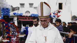 The former Cardinal Jorge Mario Bergoglio walks outside the chapel during a Mass at the Barracas neighborhood in Buenos Aires, Argentina, in 2003. Bergoglio, who became Pope Francis, is said to have the same position as his predecessors on economic matters.