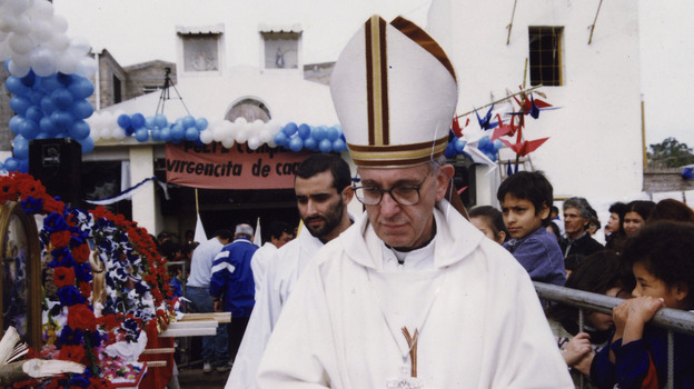 The former Cardinal Jorge Mario Bergoglio walks outside the chapel during a Mass at the Barracas neighborhood in Buenos Aires, Argentina, in 2003. Bergoglio, who became Pope Francis, is said to have the same position as his predecessors on economic matters. (AP)